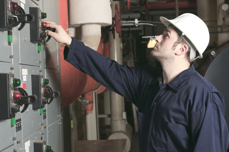 maintenance engineer checking technical data of heating system