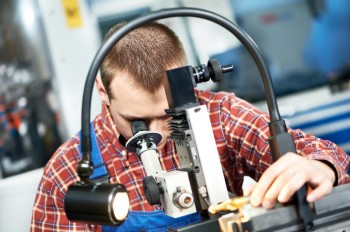 Worker's Job is to check tool with optical device