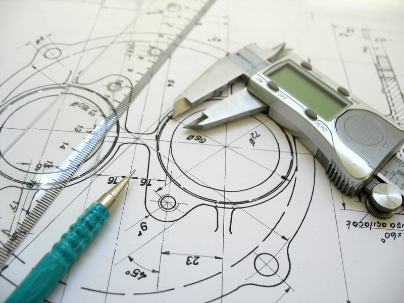 Engineering tools on technical drawing. Digital caliper, ruler and mechanical pencil