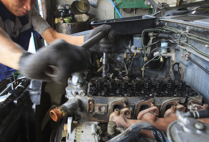 hand repair and maintenance top of  cylinder diesel engine block of light pick up truck